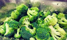Fresh cut green brocoli. Flourets, raw, resting in silver metal serving tray. Salad Topping stock images