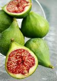Fresh cut green figs royalty free stock images