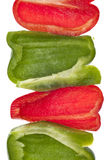 Fresh Cut Green and Red Bell Peppers Stock Images