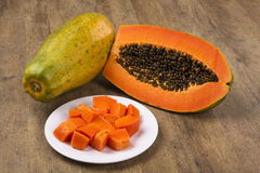 Fresh cut juicy tropical papaya mamao fruit with seeds at Brazil Royalty Free Stock Photo