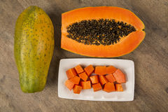 Fresh cut juicy tropical papaya mamao fruit with seeds at Brazil Royalty Free Stock Photography