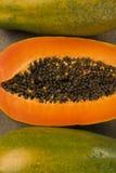 Fresh cut juicy tropical papaya mamao fruit with seeds at Brazil Stock Images