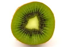 Fresh cut kiwi fruit. On a white background royalty free stock photo