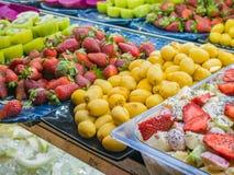 Fresh Cut Kiwi Fruits and Fruit Salad with Yogurt. Fresh Cut Kiwi Fruits, Fresh Strawberry Fruits and Fruit Salad with Yogurt ready to serve and eat stock image