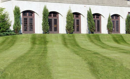 Fresh Cut Lawn. Pattern in freshly cut grass leads to building Royalty Free Stock Photos