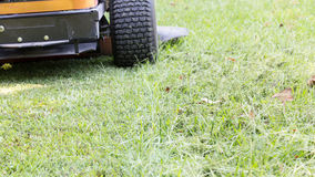 Fresh cut lawn and mower. Zero turn half finished Royalty Free Stock Photo