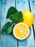 Fresh cut lemon on rustic boards Stock Photo