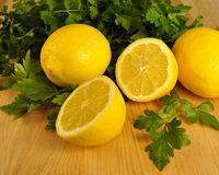 Fresh Cut Lemons and Flat Leaf Parsley Royalty Free Stock Images