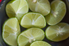 Fresh cut limes in a bowl Royalty Free Stock Image