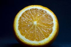 Fresh cut orange on dark background. Close up. stock photo
