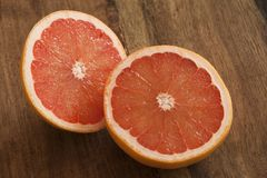 Fresh cut pink grapefruit halves Stock Photos