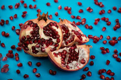 Fresh cut pomegranate. Red fresh cut pomegranate on blue background Royalty Free Stock Photo