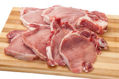 Fresh cut pork chops on wooden board Stock Photos
