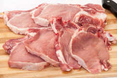 Fresh cut pork chops on wooden board Royalty Free Stock Images