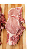 Fresh cut pork chops on wooden board Stock Photography