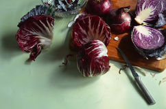 Fresh cut red cabbage on cutting board, red onion, red radicchio Stock Photography
