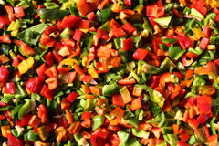 Fresh cut red, green and yellow pepper mix Royalty Free Stock Images