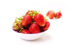 The fresh cut strawberries on white Royalty Free Stock Photography