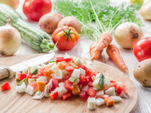 Fresh cut vegetables on the chopping board. Royalty Free Stock Photography
