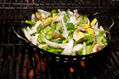 Fresh Cut Vegetables Roasting on a Grill Stock Photo