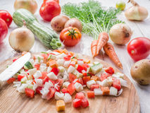 Fresh cut vegetables on the wooden board. Stock Photo