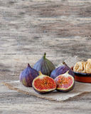 Fresh cut and whole figs. Juicy fresh figs cut in half, whole and dried Stock Image