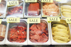 Fresh cuts of red beef meat and cutlets in store. On counter Royalty Free Stock Photos