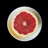 Fresh cutted grapefruit on the plate Royalty Free Stock Images