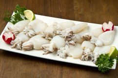 Fresh cuttlefish with peas stock photography