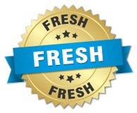 Fresh gold badge with blue ribbon. Fresh 3d gold badge with blue ribbon Royalty Free Stock Images