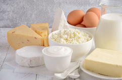 Fresh dairy products. Milk, cheese, brie, Camembert, butter, yogurt, cottage cheese and eggs on wooden table. Selective focus Royalty Free Stock Photography