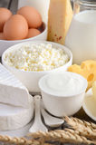 Fresh dairy products. Milk, cheese, brie, Camembert, butter, yogurt, cottage cheese and eggs on wooden table. stock image