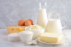 Fresh dairy products. Milk, cheese, brie, Camembert, butter, yogurt, cottage cheese and eggs on wooden table. Selective focus Royalty Free Stock Photo