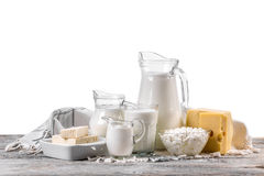 Fresh dairy products. On an old wooden board Royalty Free Stock Image