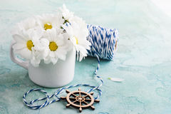 Fresh daisy flowers on pastel blue concrete table. Copy space for text, greeting card concept royalty free stock photos