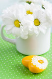 Fresh daisy flowers and yellow heart Royalty Free Stock Images