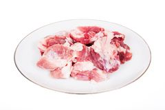 Fresh damp meat on plate insulated Stock Photography