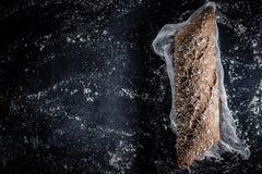 Fresh dark baguette. Stock Photos