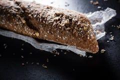 Fresh dark baguette. Royalty Free Stock Photography