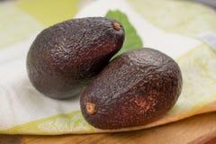 Fresh dark green organic avocado with leaf stock photography