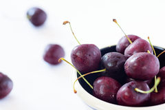 Fresh dark red cherries in a bowl Stock Photos