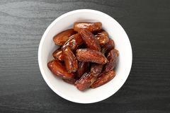 Fresh date fruit in a white bowl Royalty Free Stock Image