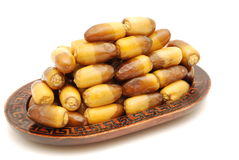 Fresh Dates. Fruits in brown plate Royalty Free Stock Images