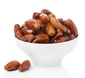 Fresh dates in bowl isolated Stock Image