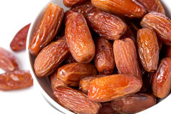 Fresh dates in bowl isolated Stock Photography