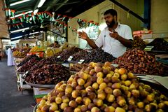 Fresh dates at a vegetable market. In dubai.nthe shops are collecting new harvest and people are getting ready for the liwa dates festival at the end of august Royalty Free Stock Photo