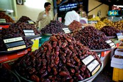 Fresh dates at a vegetable market. In dubai.nthe shops are collecting new harvest and people are getting ready for the liwa dates festival at the end of august Stock Images