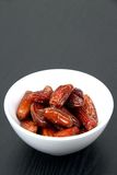 Fresh dates in a white bowl Stock Photo