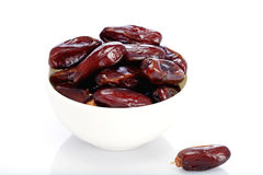 Fresh Dates in a white bowl Royalty Free Stock Photos
