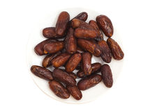 Fresh dates on white plate Stock Photo